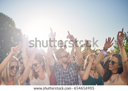 Group of people dancing at outdoor festival