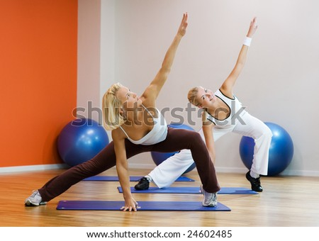 Group of people doing fitness exercise