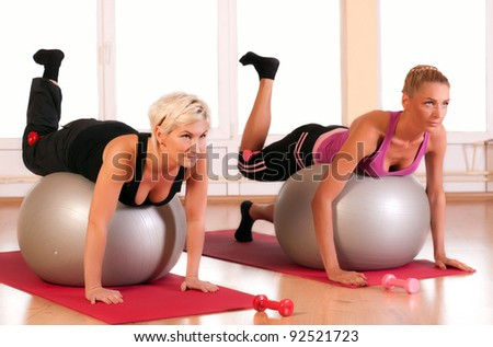 Group of people doing fitness exercise - stock photo