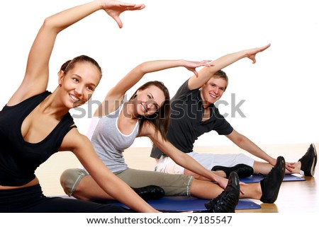 Group of People Doing Fitness Exercises in Gym