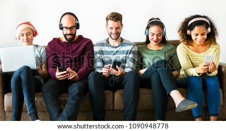 Group of people enjoying music streaming #1090948778