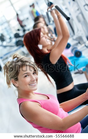 Group of people exercising with the machines at the gym