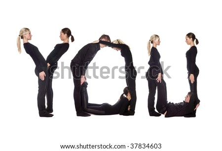 Group of people forming the word 'YOU', isolated on white background.