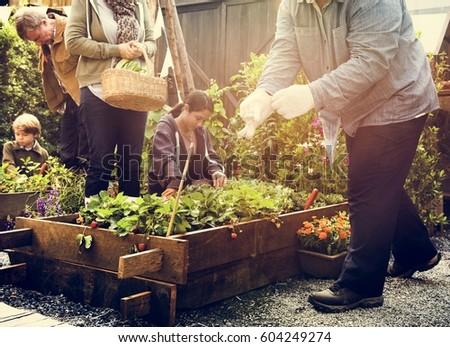 Group of people gardening backyard together #604249274
