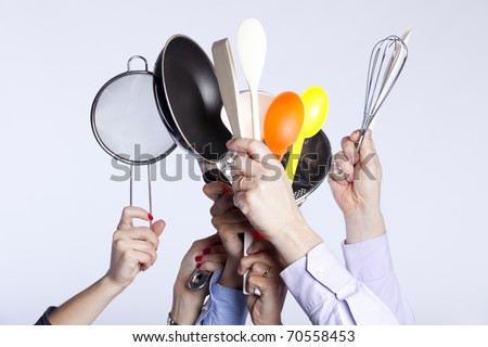 Group of people hands holding some kitchenware tools (selective focus)
