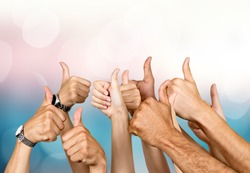 Group of people hands showing thumbs up signs