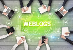 Group of people having a meeting with WEBLOGS insciption, social networking concept