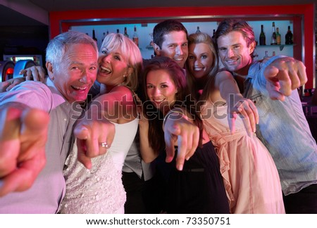 Group Of People Having Fun In Busy Bar - stock photo