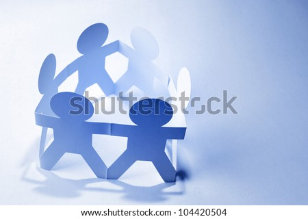 Group of people holding hands in a circle