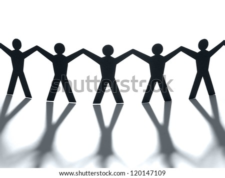 Group of people holding hands. Teamwork concept papercraft