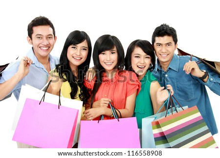 Group of people holding many shopping bags shopping together isolated on white background