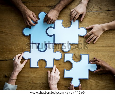 Group of People Holding Puzzle Pieces Concept