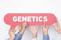 Group of people holding the GENETICS written speech bubble