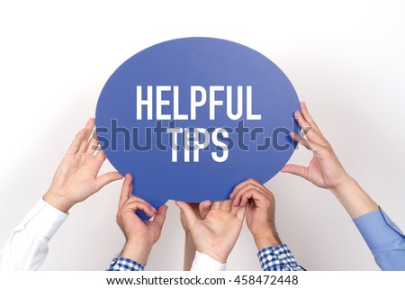 Group of people holding the HELPFUL TIPS written speech bubble