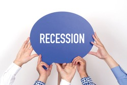 Group of people holding the RECESSION written speech bubble