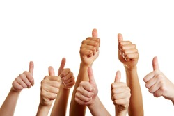 Group of people holds many thumbs up and congratulates the winner