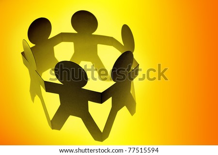 Group of people in a circle holding hands