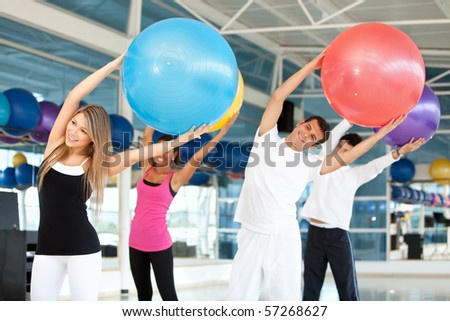 Group of people in a pilates class at the gym - stock photo