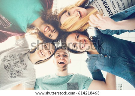 Group of people in circle . Friends looking down  . Concepts about friendship,lifestyle,unity,business and teamwork. #614218463