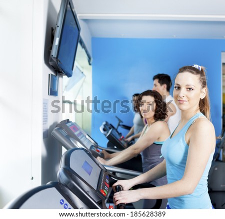 Group of people in the gym doing cardio training