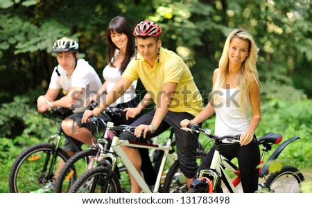 Group of people on a bicycles in a countryside - portrait
