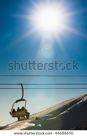 group of people on chairlift in France. Copy space
