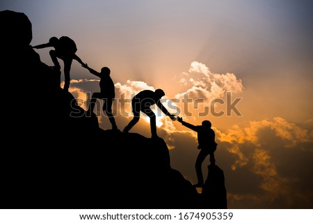 Group of people on peak mountain climbing helping team work , travel trekking success business concept Foto stock ©