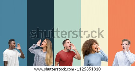 Group of people over vintage colors background shouting and screaming loud to side with hand on mouth. Communication concept.
