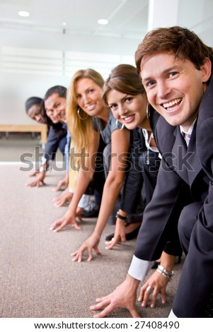 Group of people ready to race in an office