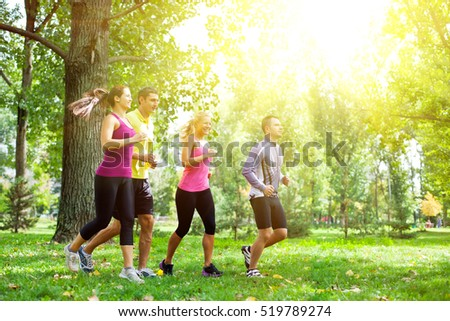 Group of people running in the park on a morning sunshine