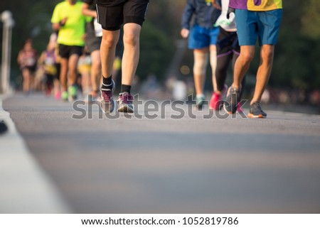 Group of people running race marathon. #1052819786