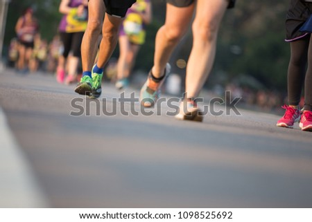 Group of people running race marathon #1098525692