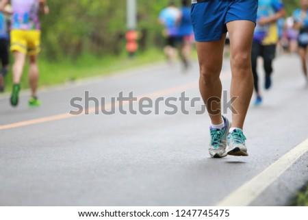 Group of people running race marathon #1247745475