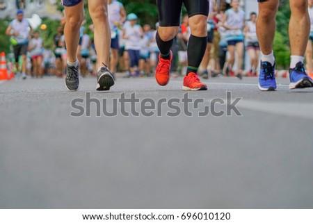 Group of people running race marathon. #696010120
