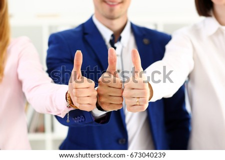 Group of people show OK or approval with thumb up during conference closeup. High level quality product, serious offer, excellent education, mediation solution, creative advisor participation concept #673040239