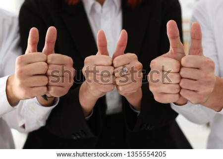 Group of people show ok or confirm with thumb up during conference closeup. High level quality product serious offer excellent education mediation solution creative advisor participation concept #1355554205