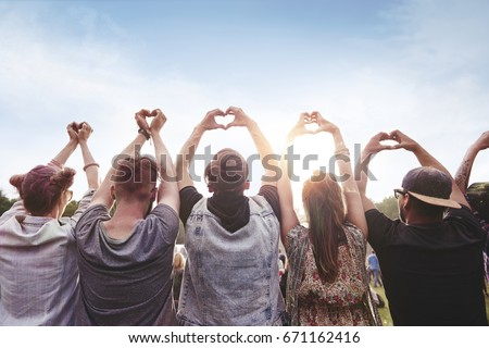 Group of people showing the heart shape