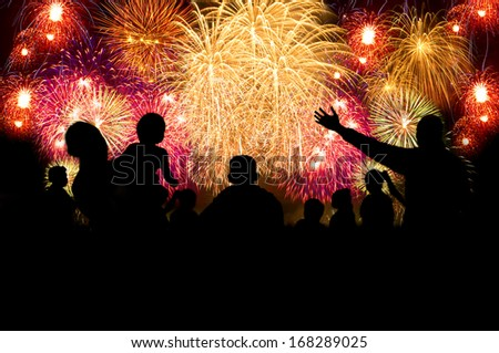 Group of people silhouette enjoy watching firework show in the night sky