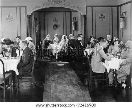 Group of people sitting in a restaurant having dinner