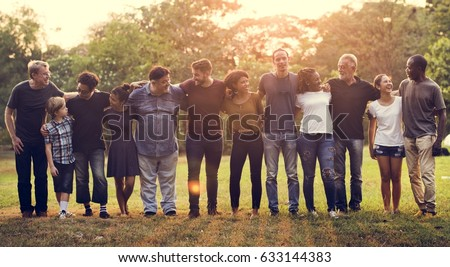 Group of people support unity arm around together