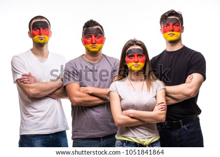 Group of people supporters fans of Germany national teams with painted flag face. Fans emotions. #1051841864