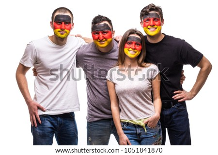 Group of people supporters fans of Germany national teams with painted flag face. Fans emotions. #1051841870