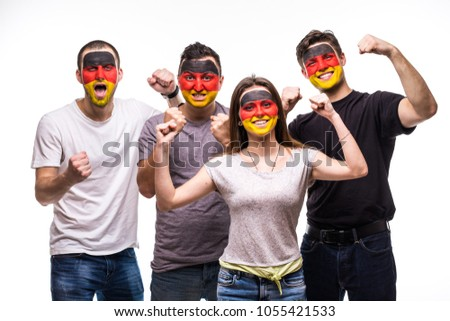Group of people supporters fans of Germany national teams with painted flag face. Fans emotions. #1055421533