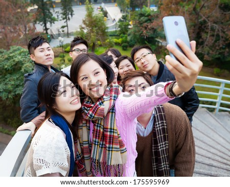 Group of people taking photo themselves