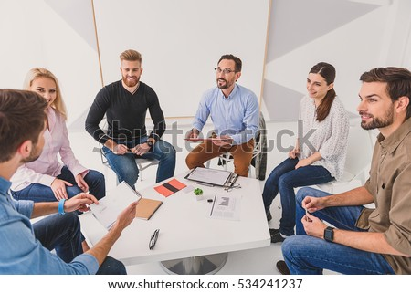 Group of people talking over