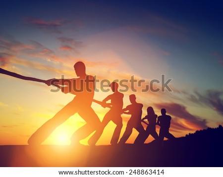 group of people  team pulling...