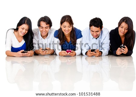 Group of people texting on their cell phones - isolated over a white background