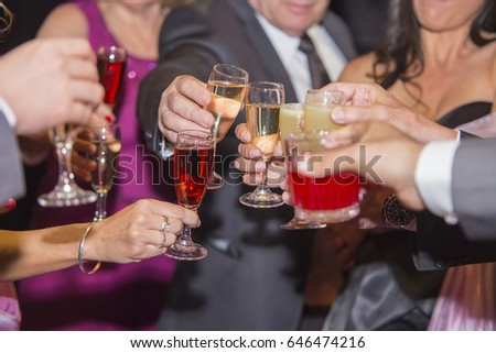 Group of people toasting at a party