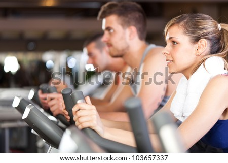Group of people training in a gym