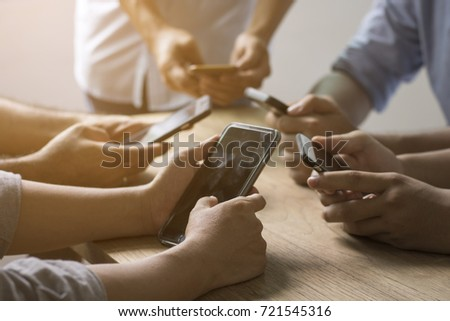group of people use phone on wood table for connect and communicate concept